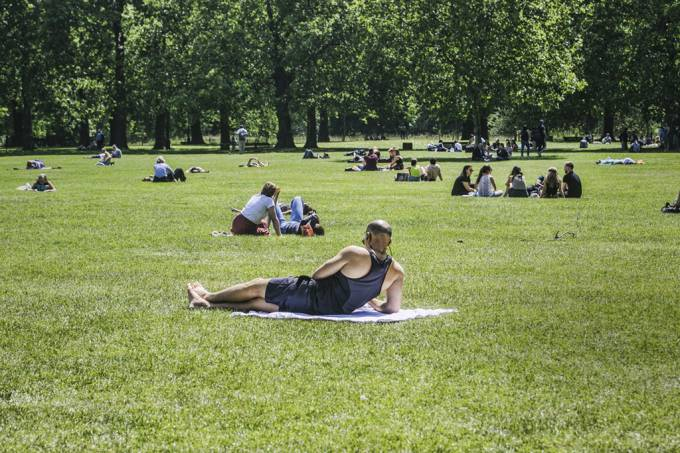 People enjoy the summer sunshine on a hot day in London as